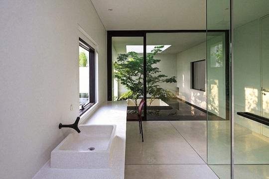 Ngôi nhà đẹp như bản tình ca với những ô vuông xanh ngẫu hứng - Ảnh 13.