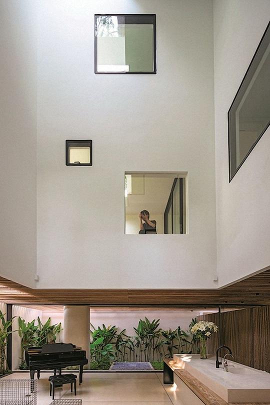 Ngôi nhà đẹp như bản tình ca với những ô vuông xanh ngẫu hứng - Ảnh 6.