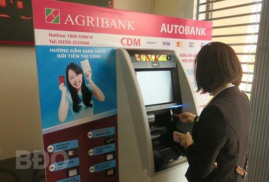 Agribank đẩy mạnh thanh toán không dùng tiền mặt nhằm hiện thực hóa chiến lược tài chính toàn diện quốc gia - Ảnh 1.