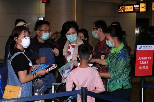 Về quê dịp Tết, hàng trăm ngàn người Trung Quốc mắc kẹt vì virus corona - Ảnh 1.
