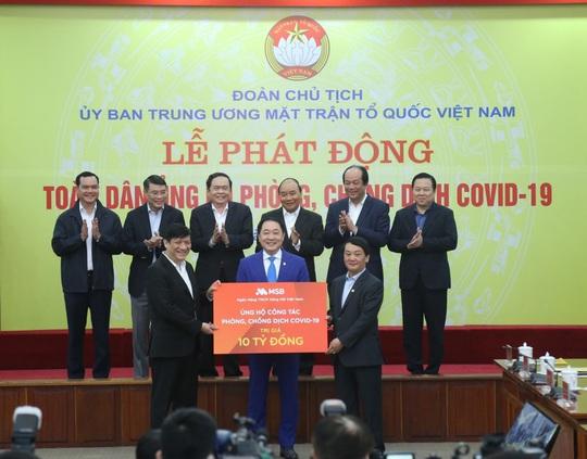 Ngành ngân hàng ủng hộ 140 tỉ đồng phòng, chống dịch Covid - 19 - Ảnh 1.