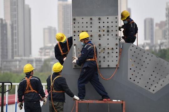 Trung Quốc tái khởi động nền kinh tế - Ảnh 1.