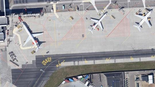 Hàng ngàn phi cơ nằm la liệt ở các sân bay trên thế giới - Ảnh 7.