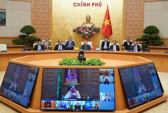 Việt Nam quyết tâm chống dịch Covid-19 - Ảnh 1.