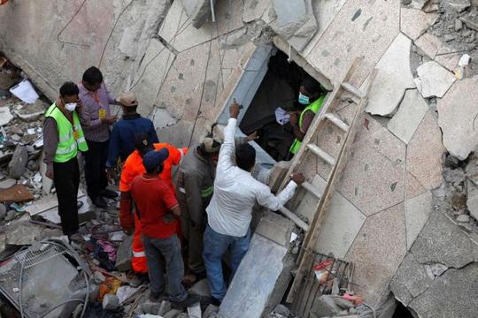 Lén xây thêm tầng, chung cư bị sập vùi chết 14 người - Ảnh 3.