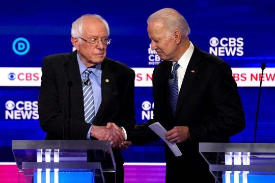 Bầu cử Mỹ: Cuộc đua song mã giữa phe ôn hòa và phe cấp tiến - Ảnh 1.