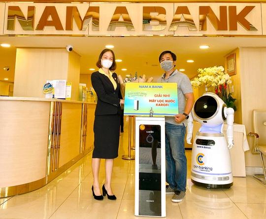Nam A Bank trao giải ô tô trị giá 1,2 tỉ đồng cho khách hàng - Ảnh 4.