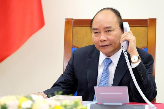 Thủ tướng Nguyễn Xuân Phúc điện đàm với Thủ tướng Trung Quốc Lý Khắc Cường - Ảnh 1.