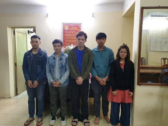 Công an TP HCM bắt nhóm người Trung Quốc cho vay lãi suất cắt cổ - Ảnh 1.