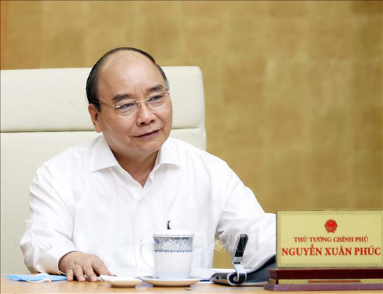 Thủ tướng đồng ý nới lỏng giãn cách xã hội, trừ 3 huyện - Ảnh 1.