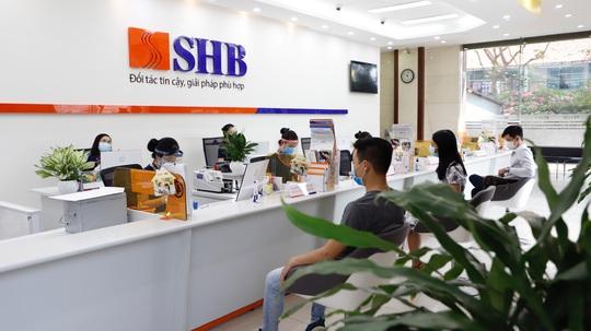 SHB tung gói tín dụng 25.000 tỉ đồng, giảm lãi suất tối thiểu 2%/năm - Ảnh 1.