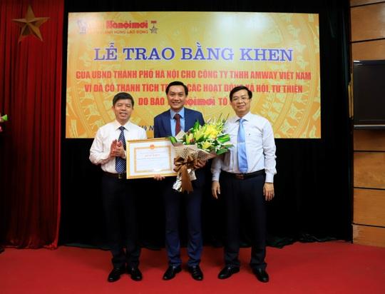 Amway Việt Nam liên tiếp nhận bằng khen của UBND TP Hà Nội và tỉnh Lạng Sơn - Ảnh 1.
