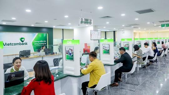 Vietcombank giảm lãi suất tiền vay giai đoạn 3 cho khách hàng bị ảnh hưởng Covid-19 - Ảnh 1.