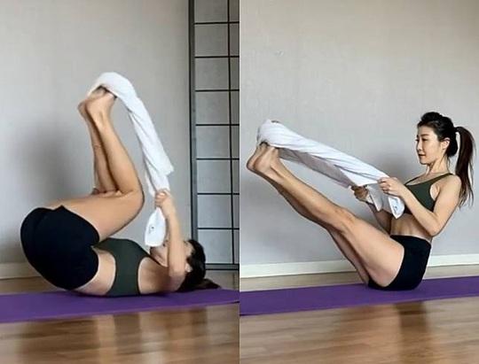 Dùng 1 chiếc khăn tắm, triển ngay 4 động tác tập trong 2 tuần để thấy bụng phẳng, eo thon hơn - Ảnh 1.