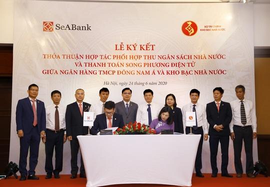 SeABank và Kho bạc Nhà nước hợp tác thu ngân sách, thanh toán song phương điện tử - Ảnh 1.