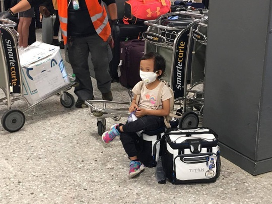 346 người Việt từ Mỹ về nước tại sân bay Nội Bài - Ảnh 5.