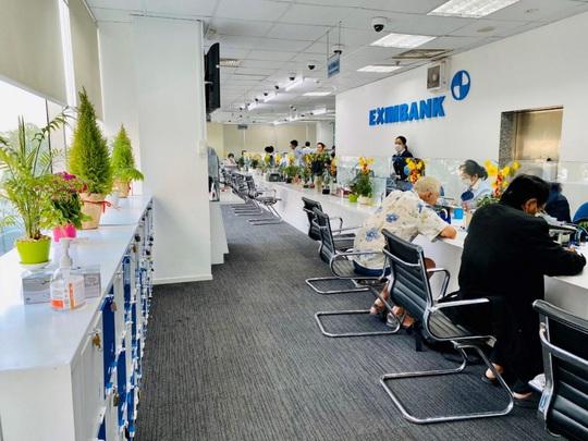 Eximbank điều chỉnh lãi suất, hỗ trợ doanh nghiệp vượt khó - Ảnh 1.