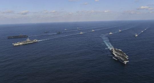 Hải quân Mỹ tập trận ở biển Đông, tàu Trung Quốc theo sát - Ảnh 1.