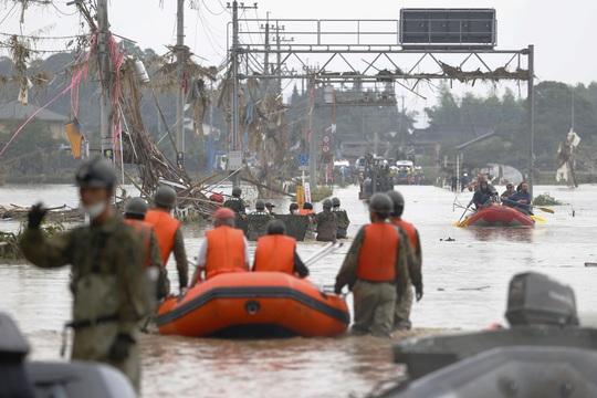 Nhật Bản, Trung Quốc tổn thất nặng vì thiên tai - Ảnh 1.