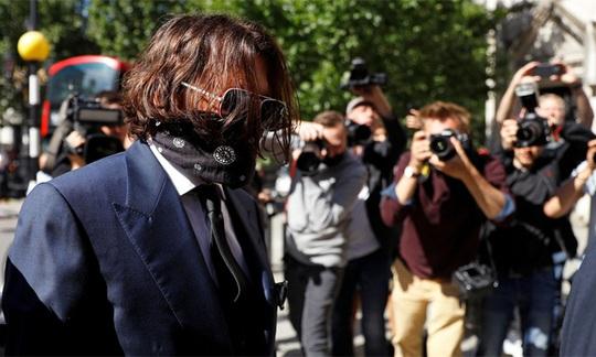 Johnny Depp kiện tờ báo, vợ cũ cũng phải ra tòa - Ảnh 1.