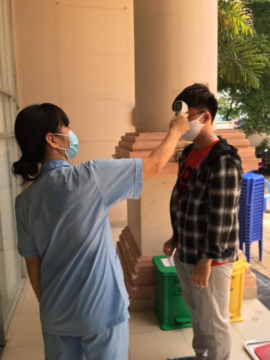 Thêm kết quả xét nghiệm 1.976 người từ Đà Nẵng đến TP HCM - Ảnh 1.