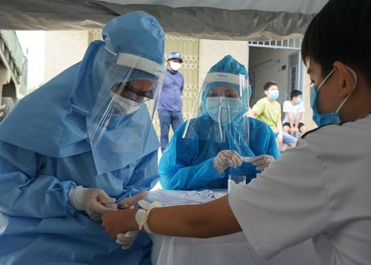 Ứng phó dịch Covid-19 nguy cơ lan rộng, Việt Nam lần đầu áp dụng gộp mẫu xét nghiệm SARS-CoV-2 - Ảnh 3.