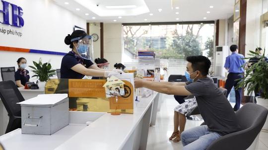 Ngân hàng Nhà nước: Đáp ứng mọi nhu cầu vốn, dịch vụ ngân hàng tại Đà Nẵng, Quảng Nam - Ảnh 1.