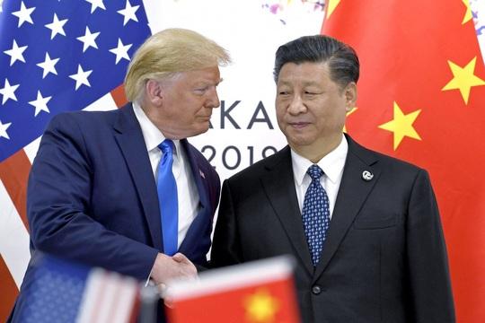 Tình báo Mỹ: Nga - Trung Quốc đấu đá vì Tổng thống Trump - Ảnh 1.