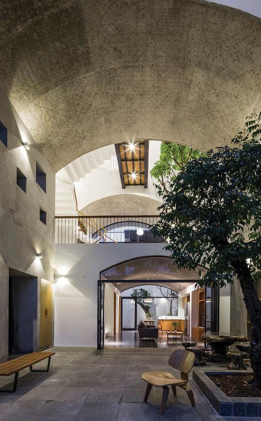 Ngôi nhà như hang động nhờ thiết kế không gian vòm độc đáo - Ảnh 6.