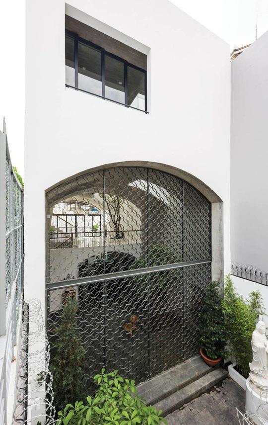 Ngôi nhà như hang động nhờ thiết kế không gian vòm độc đáo - Ảnh 7.