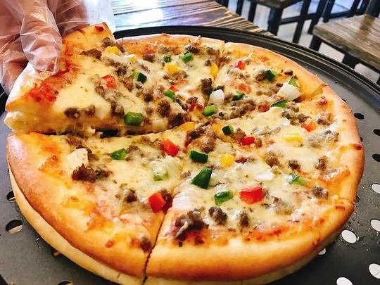 Các chuỗi pizza, burger ở Việt Nam kinh doanh thế nào? - Ảnh 1.