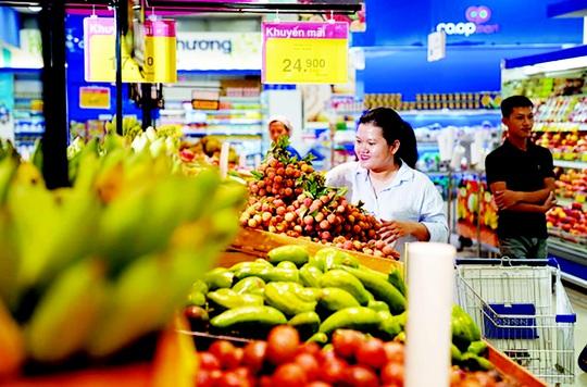 Sản phẩm các địa phương tìm đường vào siêu thị - Ảnh 1.
