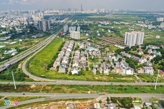 Bãi bỏ bảng giá đất có thể kéo giá nhà ở giảm xuống - Ảnh 1.