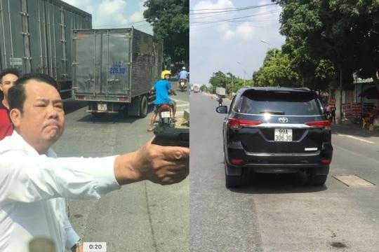 Người rút súng dọa bắn vỡ sọ tài xế là giám đốc công ty bảo vệ - Ảnh 1.