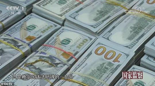 Video 3 tấn tiền mặt chất như núi trong nhà quan tham Trung Quốc - Ảnh 5.