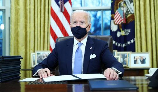 Sau lễ nhậm chức, ông Biden hủy bỏ nhiều sắc lệnh dưới thời ông Trump - Ảnh 2.