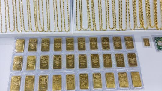 Giá vàng hôm nay 28-1: Giảm mạnh ồ ạt, các quỹ đầu tư đồng loạt bán vàng - Ảnh 2.