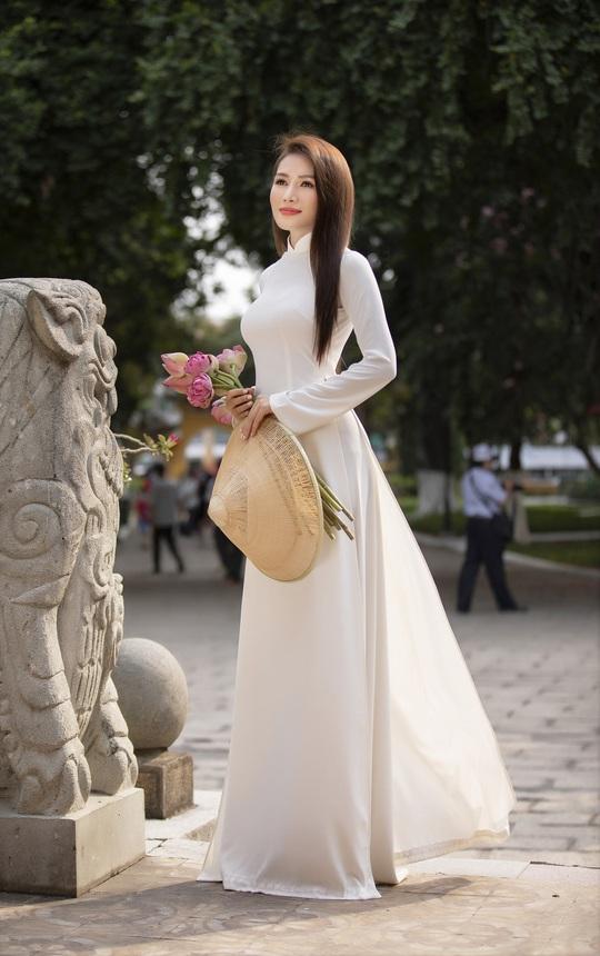 Thúy Diễm, Văn Phượng... khoe sắc rạng ngời đón Xuân Tân Sửu - Ảnh 32.