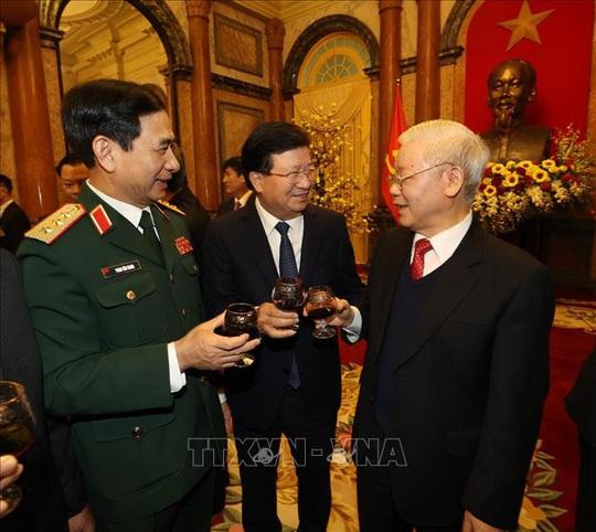 Tổng Bí thư, Chủ tịch nước Nguyễn Phú Trọng chủ trì gặp mặt, chúc Tết - Ảnh 7.