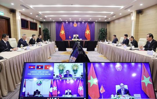 Việt Nam, Lào, Campuchia nhất trí tiếp tục tạo điều kiện thông quan thuận lợi qua các cửa khẩu - Ảnh 3.