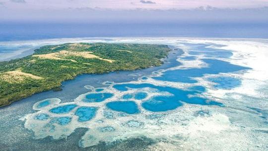 Kỳ lạ hòn đảo nơi người dân dùng tiền xu khổng lồ nặng tới 4 tấn - Ảnh 5.