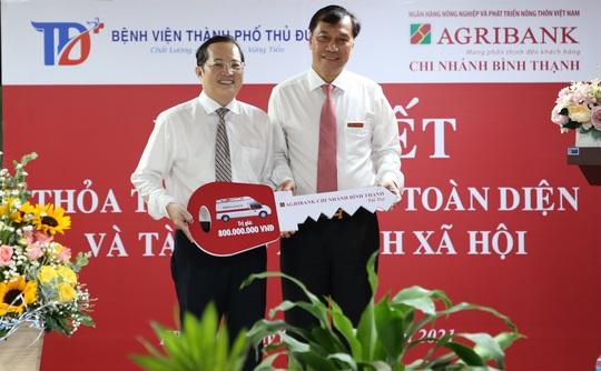 Agribank Chi nhánh Bình Thạnh ký kết thỏa thuận hợp tác với Bệnh viện TP Thủ Đức - Ảnh 2.