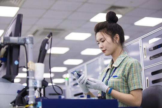 Doanh nghiệp FDI xuất siêu hơn 14 tỉ USD - Ảnh 1.