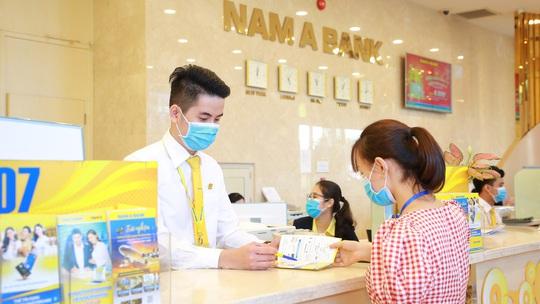 Nam A Bank dành gần 6 tỉ đồng hỗ trợ cán bộ nhân viên tiêm vắc xin phòng Covid-19 - Ảnh 1.
