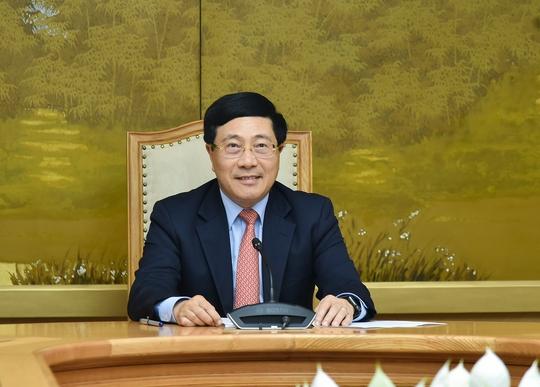 Phó Thủ tướng Phạm Bình Minh trao đổi trực tuyến với Đặc phái viên của Tổng thống Mỹ - Ảnh 2.