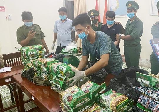 Án tử hình cho 2 kẻ vận chuyển gần 40 kg ma túy từ Campuchia về TP HCM - Ảnh 1.