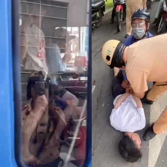CSGT TP HCM dùng súng khống chế nam thanh niên gí dao vào cổ tài xế xe buýt - Ảnh 3.