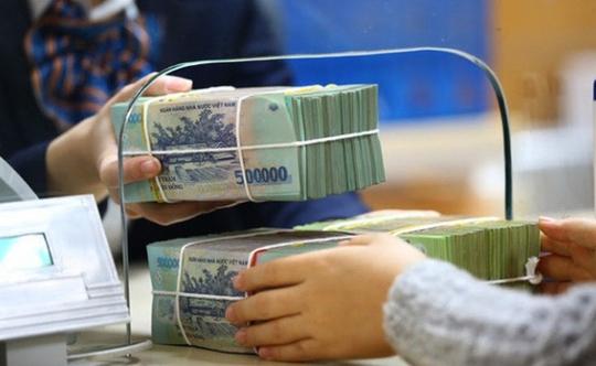 Dòng tiền chảy vào ngân hàng có dấu hiệu chậm lại - Ảnh 1.