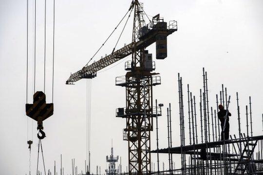 Trung Quốc kiềm chế cho vay để hạ nhiệt thị trường bất động sản - Ảnh 1.