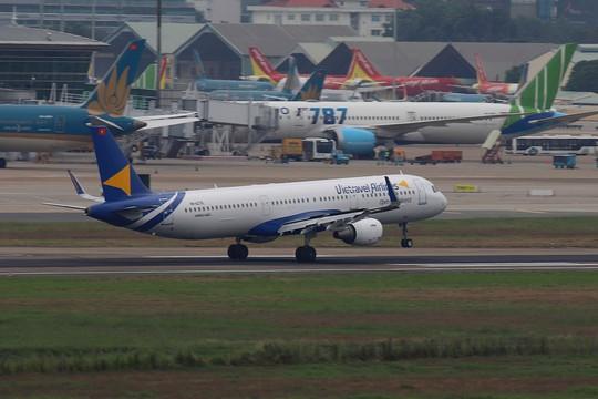 Cục Hàng không mạnh tay với các hãng bay không dùng hết slot - Ảnh 2.